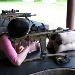 Wifey and her favorite thing to do while the SCAR 17 cools down... shoot another rifle!  She loves the ACR