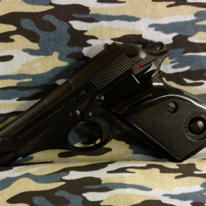 Basic black refinish on an old Beretta
