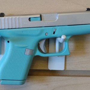 Tiffany blue and satin aluminum Glock for a customer